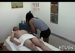 Oriental hottie gives fellow a rub with a cheerful ending