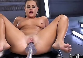 Machine babe enjoys stretching both holes