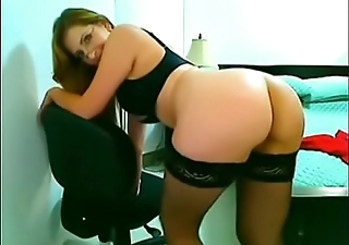 Latin Milf in red dress plays with tight pussy and smacks gorgeous ass