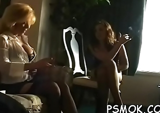 Beauty talking on the phone and playing with her shaved snatch