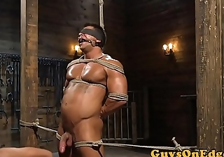 Gagged hunk edged during BDSM good-luck piece