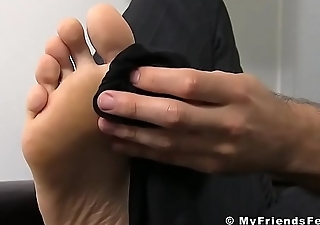 Handsome retailer presenting us anent his gorgeous feet