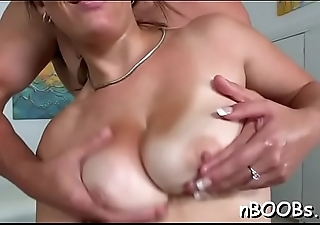 Dark gal with huge natural tits gives tit fuck and rides