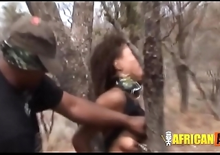 African model gets tortured close to the forest