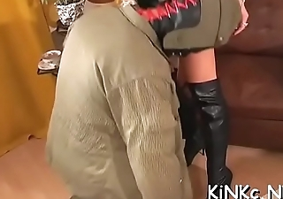 Evil female-dominator chokes and kicks tied up bondman in the balls