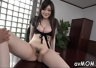 Moaning asian milf with sextoy pampers her chunky pussy making it wet