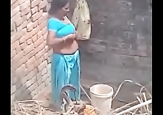 My Neighbour aunty Wash up showing her big boobs.