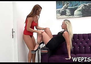 One babe is pissing while be transferred to other one is licking her vagina